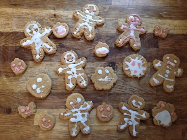 Halloween gingerbread men and biscuits iced by a child