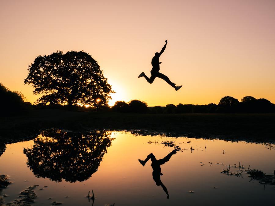figure leaping across a lake