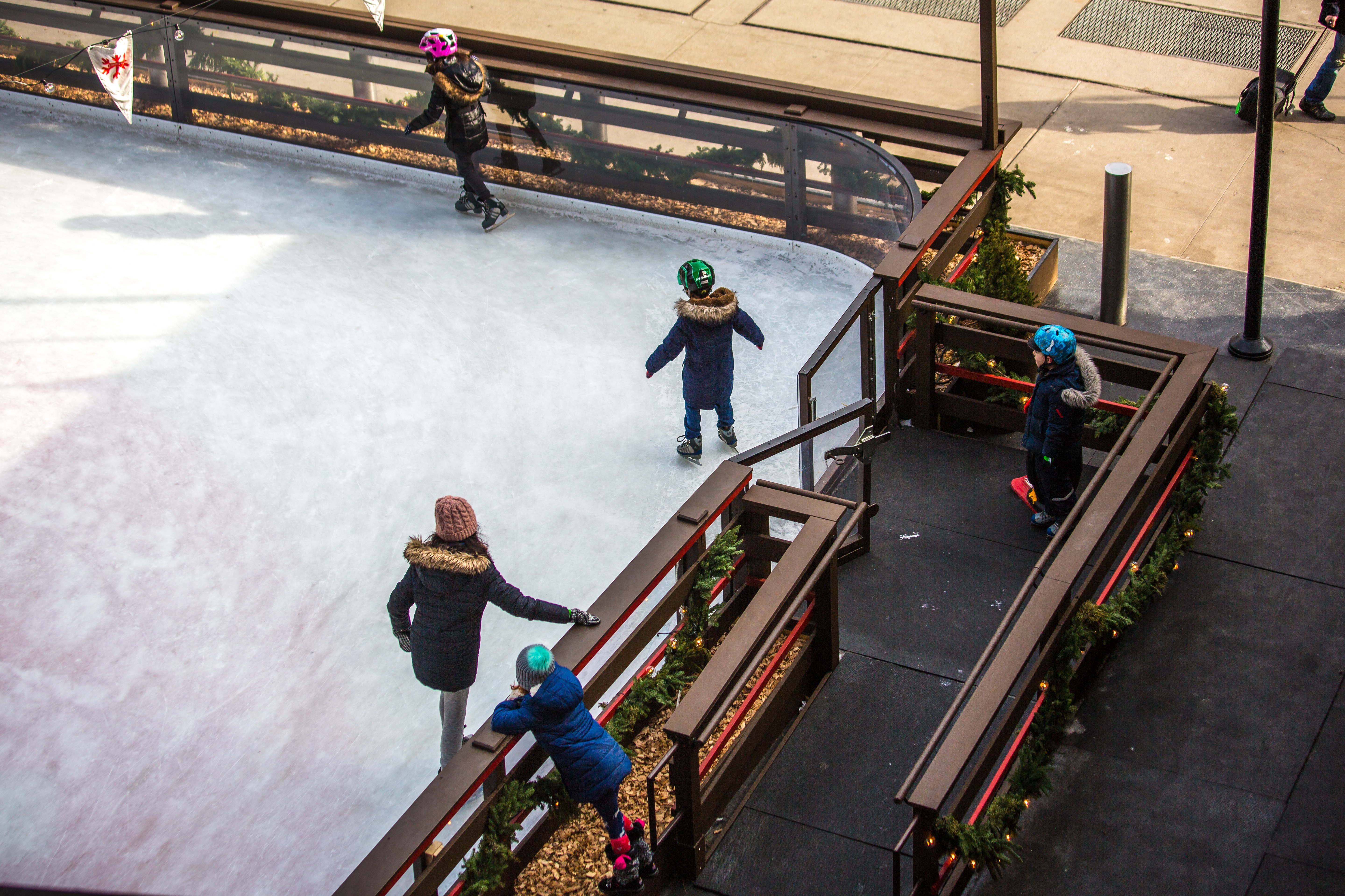 skaters on ice rink from above